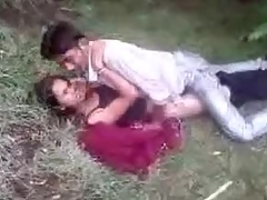 Indian duo fools around in the grass