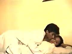 Indian couple fooling around in the sofa